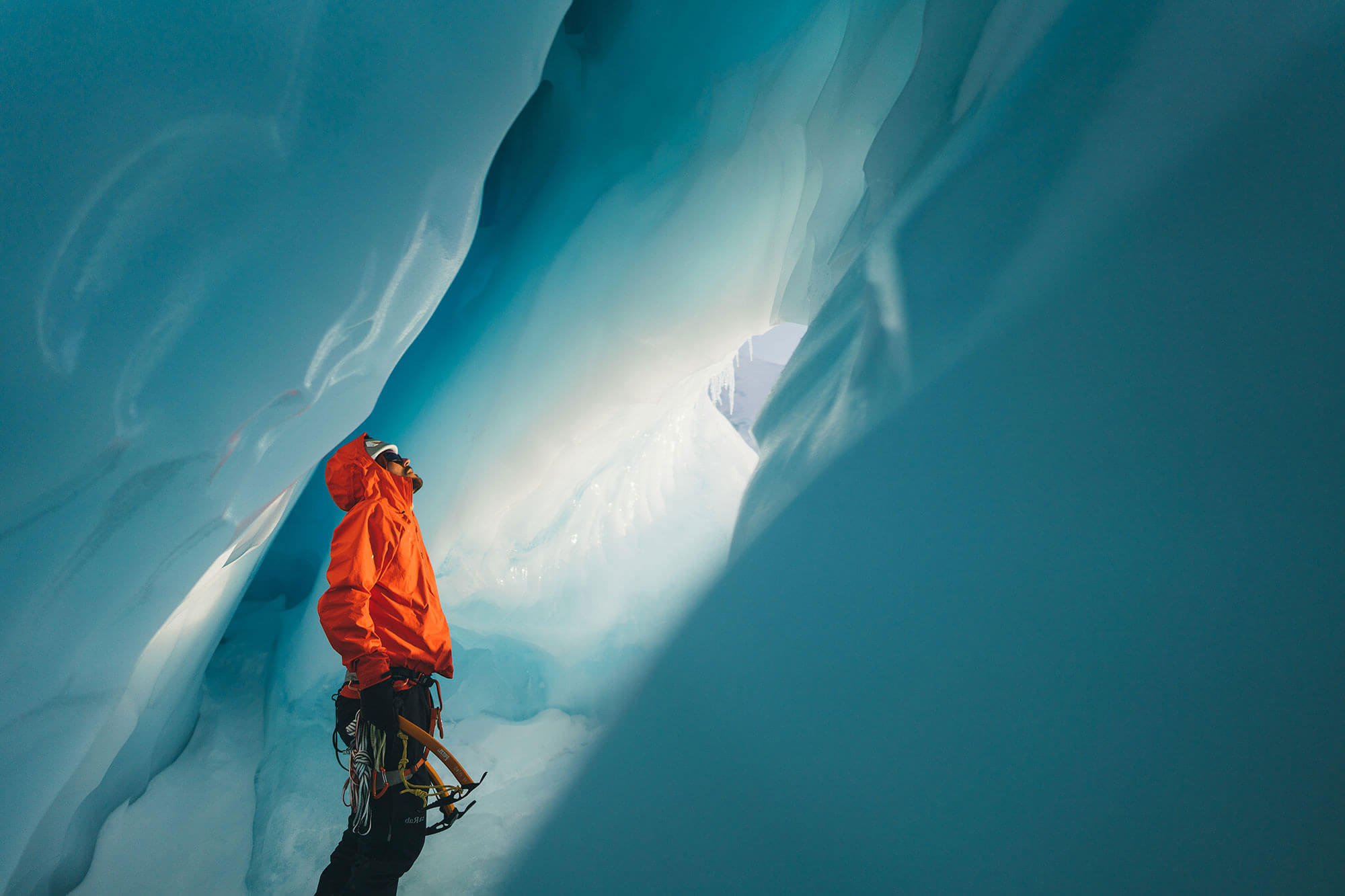 Photo of explorer in ice cavern by Stefan Haworth