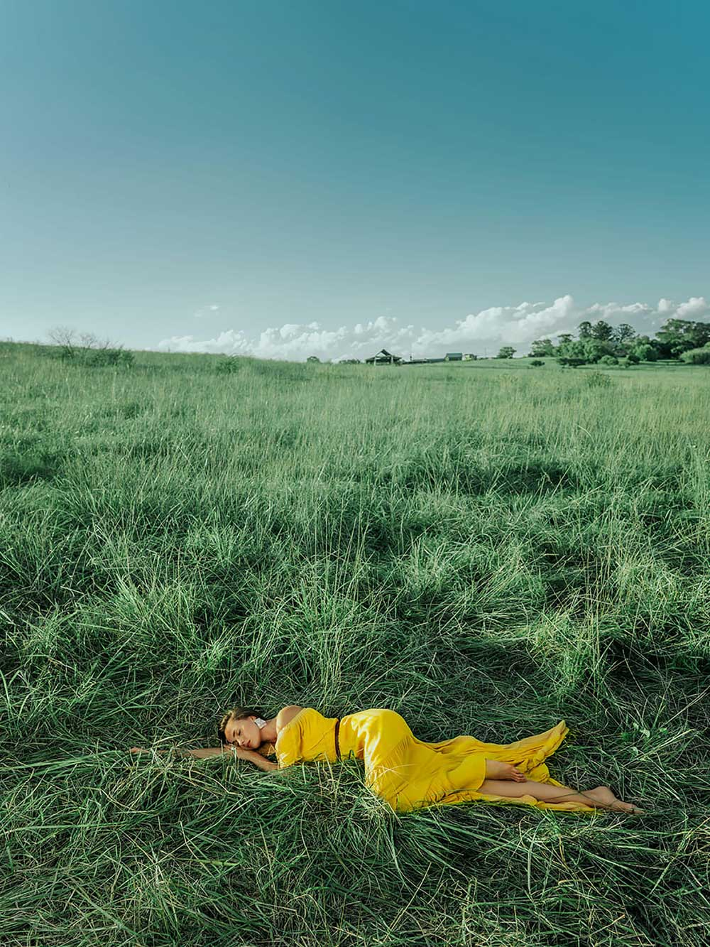 Photo of lady in a field by Aries Tao