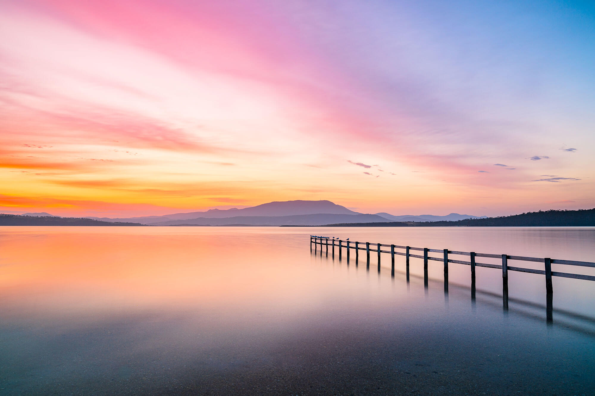 Photo of sunset over lake by Andrew Clarke